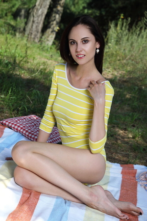 Brunette Sade Mare removes one-piece dress and poses naked at the picnic