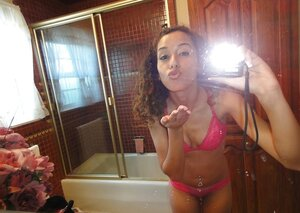 Curly Latina student gal takes some intimate pics in the bathroom