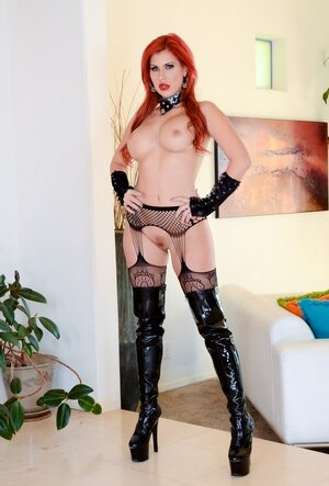 Ravishing Mom i`d like to fuck with red hair and juicy jugs poses on cam dressed in latex boots