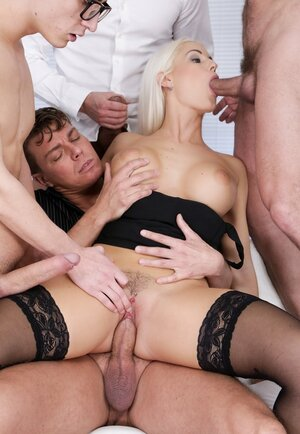 Big-boobied blonde goddess able to serve four meatsticks simultaneously