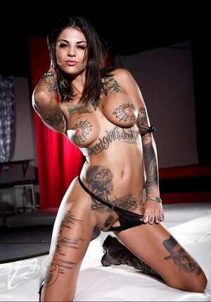 Dames have tattoos and strip on camera vying with each supplementary to be the sexiest
