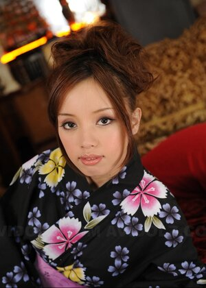 Good-tempered adult model from Japan poses on camera dressed in lovely kimono