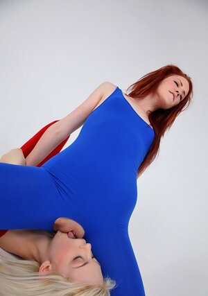Blonde and plus redhead practice lesbian sex without taking off provocative outfits