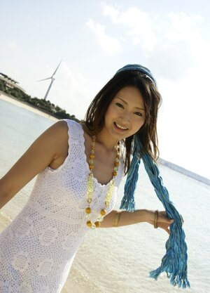 Smoking hot Japanese girl in white dress walks into the water being dressed