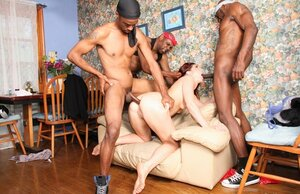 White slut with red hair has interracial foursome with dp