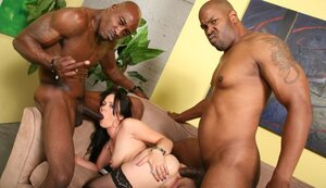 Seducing pale-skinned slut enjoys black cocks in cunt and asshole at just one time