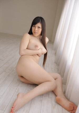 Undressed Japanese cutie gladly demonstrates exceptional natural big tits on cam