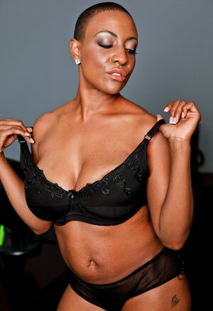 Short-haired Ebony Soccer mom strips to underwear and playfully pushes bra a little