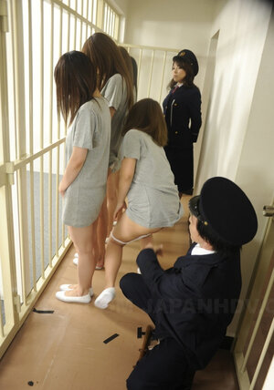 Asiatic beauty can't resist jail warden taking her panties down and watching asshole