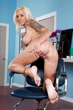Tempting blonde adult video star flirts on camera waiting for clients in the nude